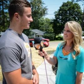 Freshman Dillon Bates interviews at the Habitat dedication on July 30, 2014