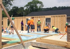 About 40 members of the football team help build a Habitat for Humanity home.