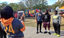 Zenobia Dobson snaps a picture of Vols' Todd Kelly Jr., son Zack Dobson and Ladarius Sackey